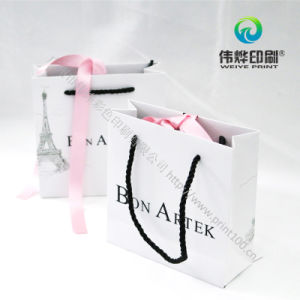 Beautiful Paper Printing Bag with Silk Ribbon Emboss Logo Acceptable pictures & photos