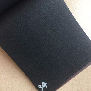 Stock Black Elastic Back PVC Leather for Handbags Clutches Hx-B1760 pictures & photos