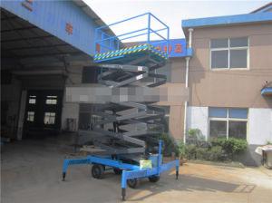 Manual Mobile Aerial Scissor Work Lift Elevator (SJY0.5-11) pictures & photos