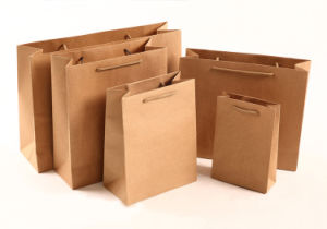 Custom Kraft Paper Gift Shopping Bag with Handles pictures & photos