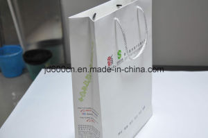 Low Price Customized Shopping Kraft Paper Bag for Gift Packaging with Handle pictures & photos