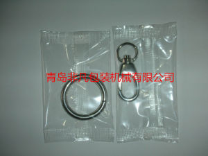 Automatic Hardware Flow Packaging/ Packing Machine pictures & photos