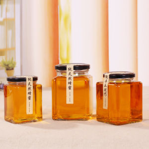 300ml 500ml 1000ml Honey Glass Jar for Food with Metal Lid, Pickle Glass Bottles pictures & photos