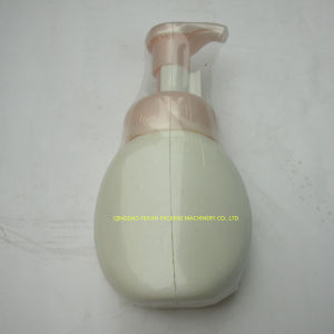 China Factory Price Automatic Cosmetic Bottles Shrink Packing Machine pictures & photos