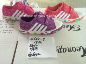 Children Cheap Stock Sports Shoesgood Quality Injection Canvas Shoes (H688-9) pictures & photos
