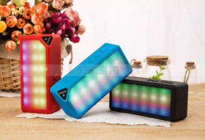 Cheap Rainbow Mini Portable Square Silicone LED Speakers Wireless Water Cube Bluetooth Speaker with Flashing Colorful LED Light pictures & photos