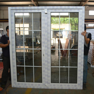White Colour UPVC Profile Casement Door with Grid K02034 pictures & photos