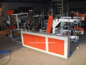 Perforated Flat Open Bag/T-Shirt Bag on Roll Making Machine pictures & photos