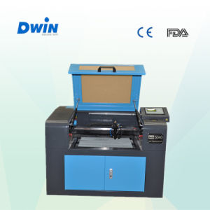 Distributors Wanted CO2 Laser Engraving Machine (DW5040) pictures & photos