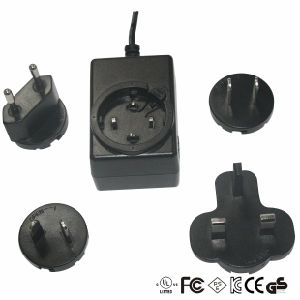 Changeable DC Adaptor with Us/UK/EU/Au Plug