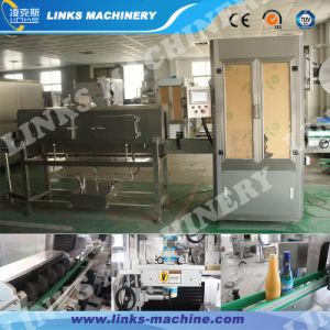 Automatic Plastic Bottle Label Shrinking Machinery pictures & photos