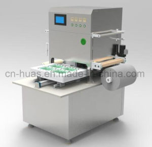 (Pre-made-package box) Semi-Automatic Tray Packing Machine for Food pictures & photos