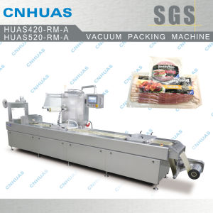 Automatic Stretch Film Vacuum Packing Machine for Food pictures & photos