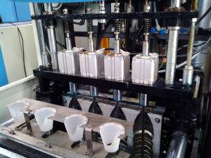 Semi-Auto Pet Blow Molding Machine for Pet Water Bottle pictures & photos