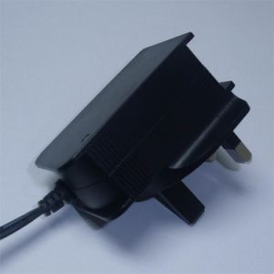 UK Wall Plug-in 5V 9V 12V 24V 0.25A 0.5A 1A AC/DC Power Adapter pictures & photos