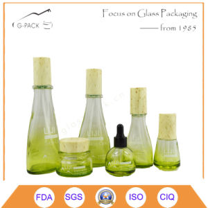 Glass Perfume Bottle and Cream Jars with Wood Caps pictures & photos