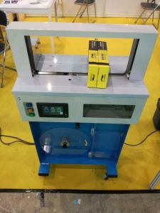 Banding Machine Feeding with Paper Tape or OPP Tape pictures & photos