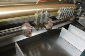 Plastic Roller Paper Feeding & Gluing Machine (YX-650B) pictures & photos