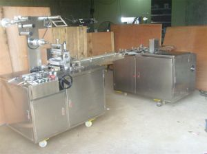 Model Sy-60 BOPP Cellophane Packaging Machine (with tear tape) pictures & photos