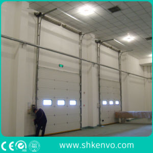 Automatic Electric Motorized Industrial Thermal Insulated Overhead Sectional Warehouse Garage Door pictures & photos