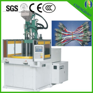 Vertical Plastic Injection Molding Machine with Rotary pictures & photos