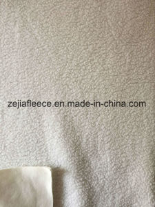 100% Polyester DTY Sherpa Fleece Fabric pictures & photos