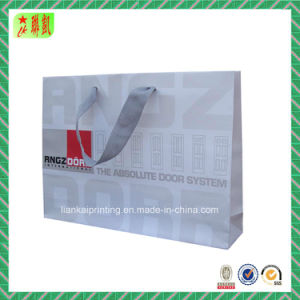 Luxury Printed Shopping Paper Bag with Ribbons pictures & photos