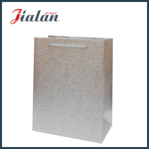 Special with Embossing Flowers Ivory Paper Shopping Gift Paper Bag pictures & photos