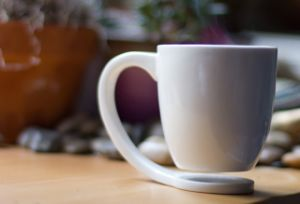 Newest Hot Sale Suspension White Custom Logo Ceramic Coffee Mugs pictures & photos