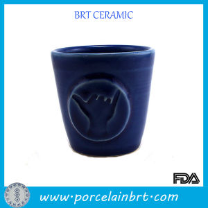Light Blue Ceramic Embossed Finger Logo Juice Cup pictures & photos