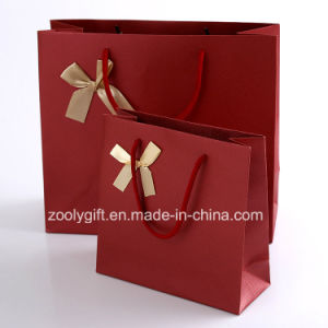 Quality Textured Art Paper Carrier Bags with Ribbon Bow / Red Color Wedding Paper Gift Bag pictures & photos