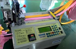 Hot Knife Automatic Tape Cutting Machine pictures & photos