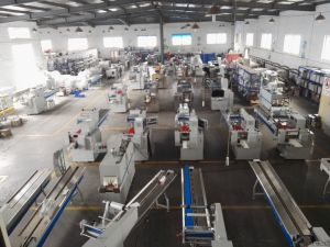 PLC Control Automatic Yakult Bottle Shrink Wrapping Machine pictures & photos