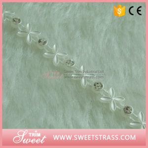 White Flower Plastic Ribbon Tape with Clear Crystals pictures & photos