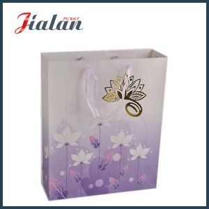 Lotus Flowers Printed and Hot Stamping Shopping Gift Paper Bag pictures & photos