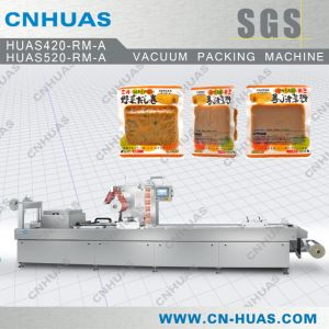 Automatic Stretch Film Packaging Machine Cakes and Cookies pictures & photos