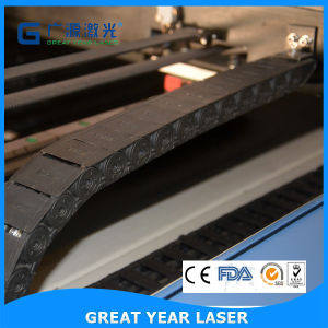 Gy-1390CS Automatic Move Laser Head Metal/Non-Metal Mix Laser Cutting Machine pictures & photos