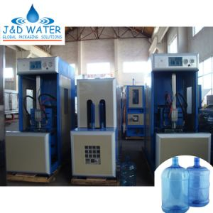 Semi-Auto Reheat Stretch Pet Bottle Blow Moulding Machine (JND-90) pictures & photos