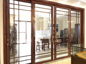 Customjzied High Quality Aluminum Sliding Door with Built-in Grid pictures & photos