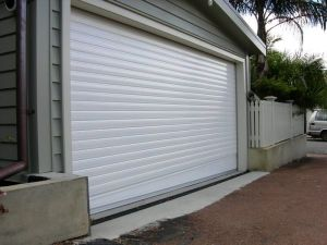 Wind Proof Insulated Galvanized Steel / Gi / Prepainted / Rolling Shutter Door pictures & photos
