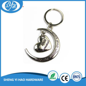 Beauty Iron on Metal Black Plating Keychain pictures & photos