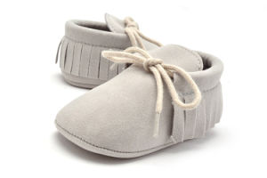 Wholesale Tassel Shoes Soft Soles Lace-UPS Shoes Indoor Toddle Shoes with Nubuck Upper pictures & photos