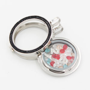 Custom Made Memory Locket with Glass Coin & Small Elements Inside pictures & photos