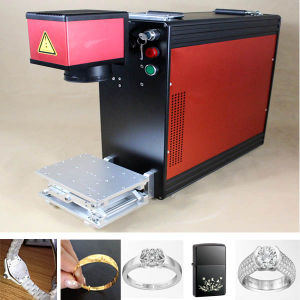 Portable Fiber Laser Marking Machine on Pens pictures & photos
