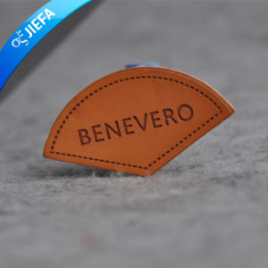 Custom Embossed PU Brand Name Leather Label for Uniforms pictures & photos