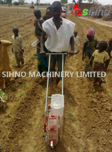 Walking Behind Hand Push Manual Seeder for Corn/Bean/Peanut/Vegetable pictures & photos