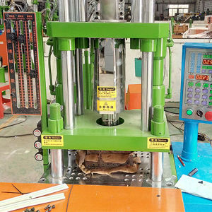 PVC Vertical Plastic Injection Moulding Mold Machine pictures & photos
