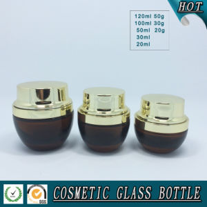 Amber Coloured Cosmetics Glass Bottle and Glass Cream Jar with Shining Gold Lid pictures & photos