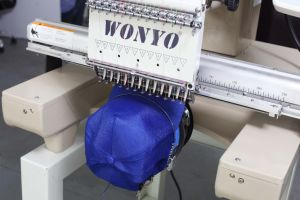 Single Head 12 Colors Cap/T-Shirt/Flat Embroidery Machine pictures & photos