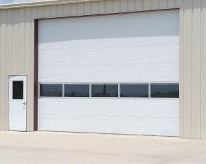 Overhead Vertical Sectional Panel Industrial Rolling Steel Doors (Hz-SD021) pictures & photos